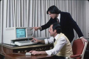 Apple computer Chrmn. Steve Jobs (R) and technician w. new LISA computer during press preview.